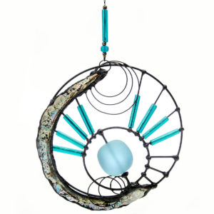 Connecting the Energies Turquoise glass bead spinning in the centre of the moon shaped Perlemoen shell.
