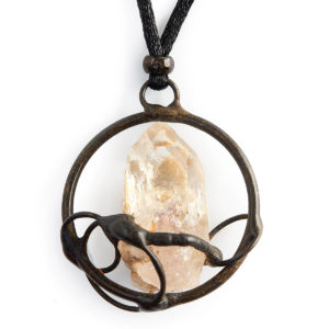 Citrine Crystal set in a Circles. Citrine attracts abundance on all levels. Strengthens memory & self confidence. The circles playfully surround the magnificent crystal supporting & receiving all good things.