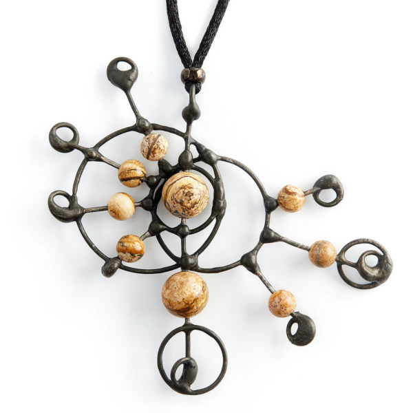This stone shows us the magnificent beauty in our landscapes. Each bead spinning on its own axel, playing with the Crop Circle design. Connecting to other planets & dimensions. Tune in, to the wonders of our worlds.