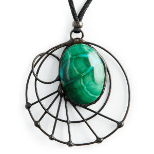 Turquoise showing through the green Malachite, reminding us that we are co-creators in this world & that the possibilities are endless. The circles & moonbeams connect to our intuitive abilities. With the healing qualities of the Malachite we can achieve all our dreams.