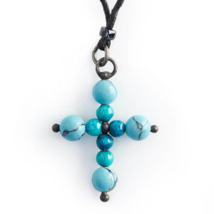 Turquoise Cross. The Cross is a Mystical symbol representing the balance of Celestial & Earth energies. Turquoise brings wisdom & kindness to any situation.