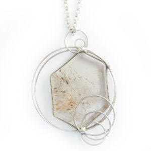 A beautiful hexagon shaped stone with Earth inclusions running through. A powerful piece to work with Nature Beings. Amplifies awareness on all levels.