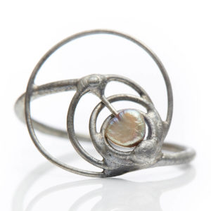 Pearl represents peace, playfully spinning in the circles.