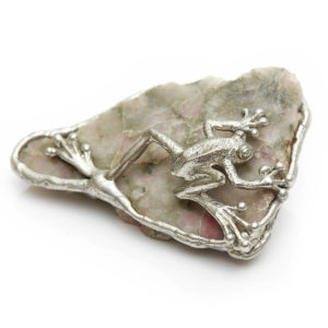 Silver Frog on Unakite Unakite balances & strengthens the Heart. Frog purifies & transforms. Hold in your hand when you meditate. Hold during meditating. Place anywhere in your home were it will bring joy.